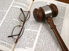 Glasses and Gavel on a Book